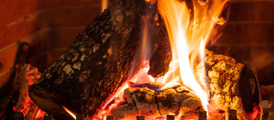 Poster Firewood texture Cozy fireplace. Wood logs burning, relaxation and warm home
