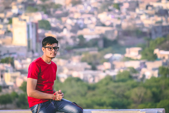 Young man wearing glasses on top of city