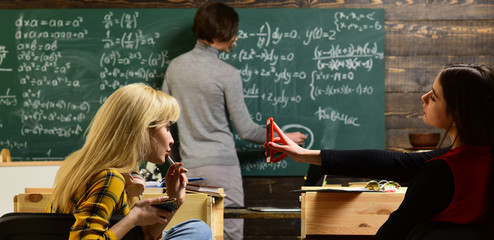 Teaching private classes is one of the best options for teacher now. Modern teacher hipster writing on big blackboard with math formula. Trying student is the one that has the most potential.