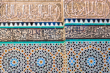 Unique Moroccan arts on the wall in Medersa Bou Inania.