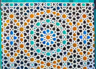 Moroccan zellige mosaic tilework on the wall, Medina of Fez, Morocco.