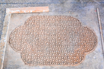 Face-down pieces of Zellige terracotta glazed tiles to form a Moroccan mosaic pattern. Medina of Fez, Morocco.