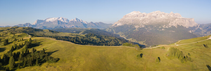 Drone aerial view at Sella group and Marmolada during summer. Alta Badia, Sud Tirol, Dolomites, Italy