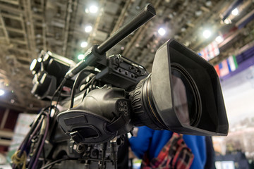 close-up television camera at sports competitions, TV broadcasting.
