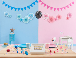Gender party, gender reveal, pink and blue wall, table and eating style.