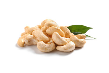 Tasty cashew nuts with leaves isolated on white