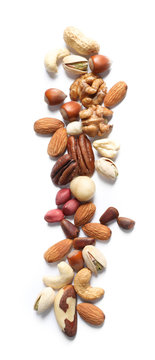 Mixed organic nuts on white background, top view