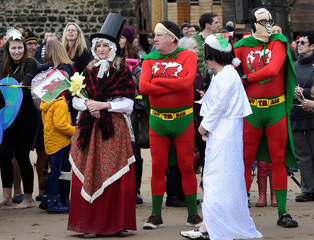 Swimmers in fancy dress take part in the 48th Boxing Day charity swim on the North Beach, Tenby