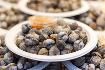 Steamed blanched cockles for cooking dinner with family at street food of Thailand