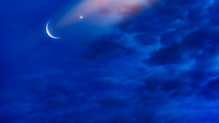 Moonlight night background . Crescent and many clouds in night sky  . Night sky with stars . Beautiful night .