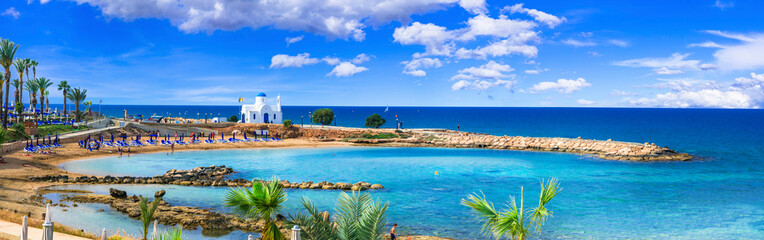 Cyprus island - best beaches. Scenic Louma beach with little church