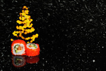 Fotorolgordijn Sushi bar Real sushi pieces of rolls Japanese cuisine on black snow background. Chritmas. New year.