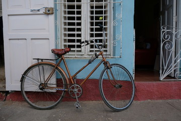 bicycle in front of old house in cuba