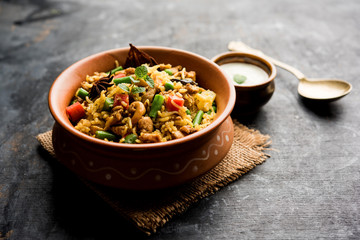 Kheema Pulao - Rice cooked with mutton or chicken mince with vegetables and spices. served in a bowl. selective focus
