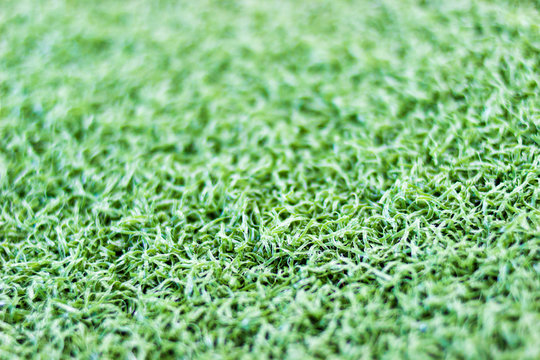 Green artificial turf close up