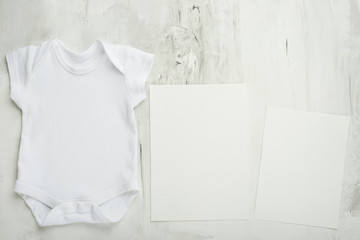 Layout Flat Put on a two white baby body shirt, on a white background. Layout for design and placement of logos, advertising