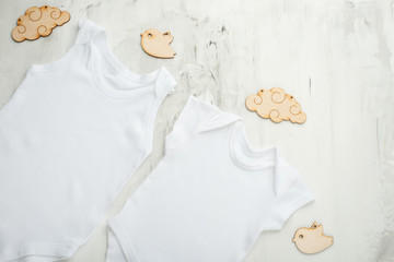 Layout Flat. Put on a two white children's body shirt, on a white background with children's wooden toys. Layout for design and placement of logos, advertising