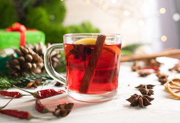 Winter drink with spices on festive new year background