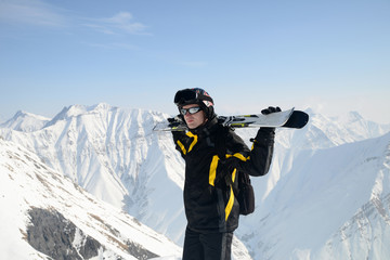 Young man skiing in the mountains