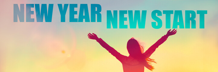 New Year 2019 New Start motivational inspirational quote on banner. Silhouette of winner woman in sunset with arms up in success.