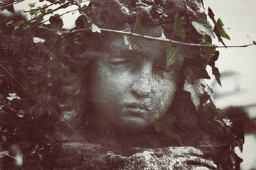 Fotomurales - Vintage styled image of ancient sad angel statue. Fragment of sculpture. (religion, faith, death, resurrection, eternity concept)