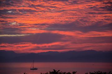 Poster Crimson Fiery sunrise over the bay near Punta de Mita, near Bucerias and Puerta Vallarta, Mexico