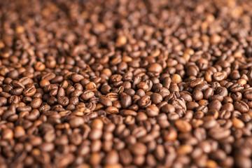 Coffee beans heap close up
