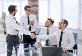 business colleagues shaking hands in the workplace