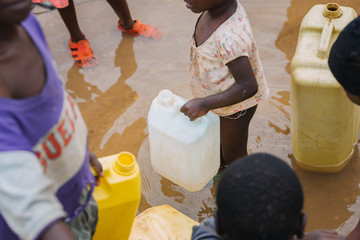 Children fetching water in Uganda, Africa