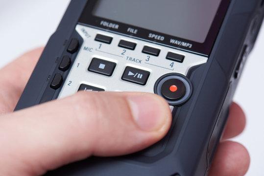 Audiorecorder in hand close up
