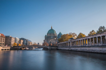 Poster Berlin Berlin Cathedral with the Friedrich's Bridge at blue sky. Arcade of the National Gallery on the river bank of the river Spree with buildings of the capital Berlin