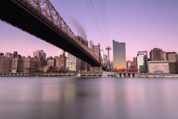 View on Queensboro bridge with tram at sunrise ,long exposure shot
