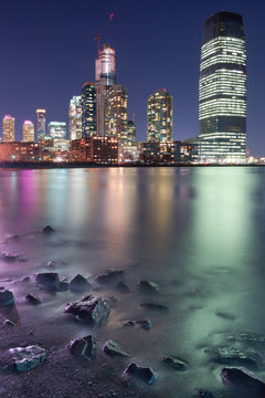 View on Jersey city skyscraper from the beach at night  with long exposure