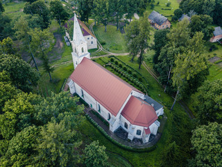 Aerial Photo of an Old Lutheran Church in Countryside Between Trees in Early Spring on Sunny Day, Close up