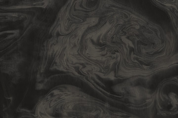 Luxury gold marble ink paper texture on dark watercolor background. Chaotic abstract organic design. Bath bomb waves.