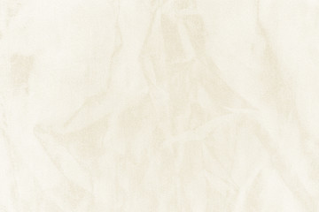 Luxury gold textile background. Silk cloth texture. Fabric pattern.