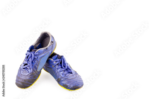 f70b054005f Old used blue worn out futsal sports shoes on white background soccer sportware  object isolated
