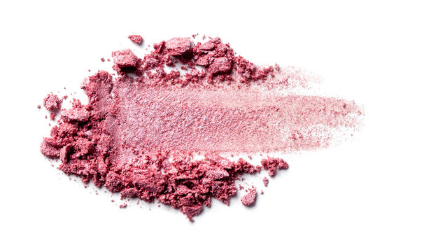 Eye shadow on a white background. Scattered blush sample for makeup. Red color.