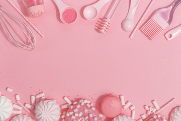Kitchenware and tools, pastry and sweets on a pink background. Top view. Copy space.
