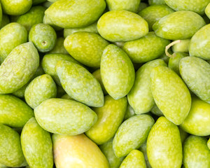 uncooked raw olives closeup, natural green background