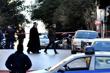 A Greek Orthodox priest arrives at the Saint Dionysios church, following the detonation of an explosive device in Athens