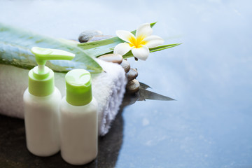Towel and cream tubes for treatment. Body care and spa concept