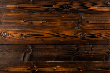 Dark brown wooden background with high resolution. Top view.
