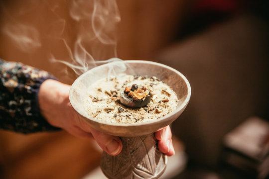 Traditional (esoteric) incense ritual at Sylvester and Christmas, smoke