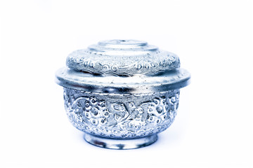 Close up of white or silver colored shiny container isolated on white.