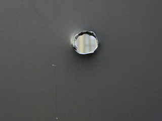 Bullet hole on steel plate