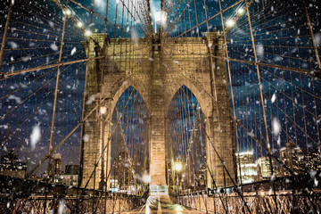 Wall Mural - Brooklyn Bridge New York City with snowflakes falling during winter snow storm
