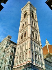 Low angle view of the bell tower near the Santa Maria del Fiore Church, Florence, Italy