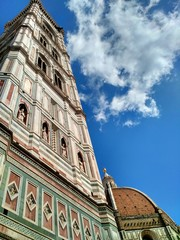 Low angle view of Giotto's bell tower and Brunelleschi's dome, Santa Maria del Fiore Cathedral (Duomo di Firenze), Florence (UNESCO World Heritage Site)