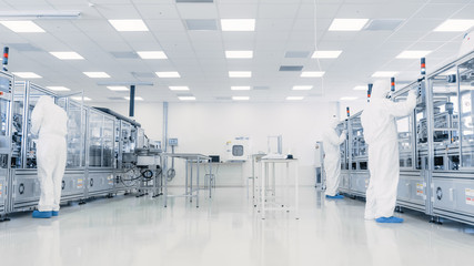 Team of Research Scientists in Sterile Suits Working with Computers, Microscopes and Modern Industrial Machinery in the Laboratory. Product Manufacturing Process: Pharmaceutics, Biotechnology. Wall mural